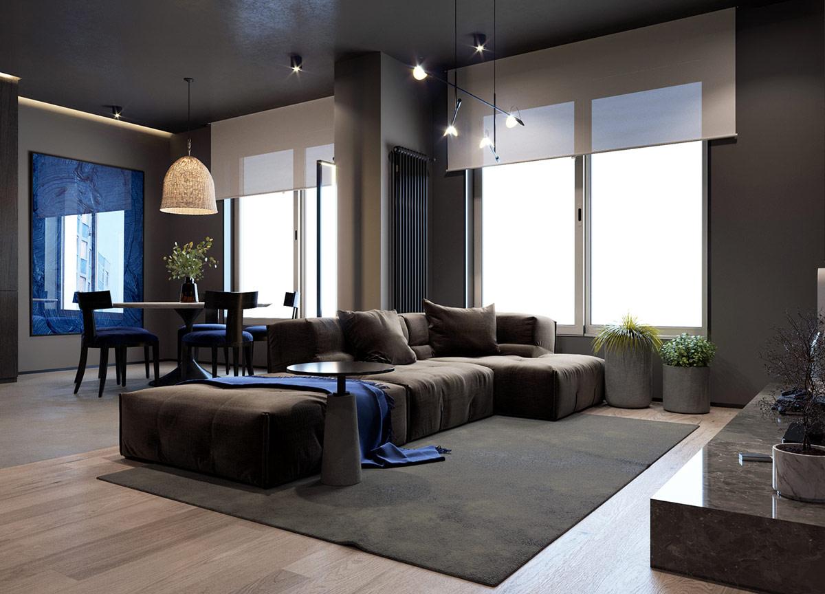 Một tấm thảm đen và bàn nhỏ bên cạnh hoàn thành việc sắp xếp tất cả các phòng chờ màu đen. Một bộ tản nhiệt thẳng đứng màu đen làm tối bức tường xám.