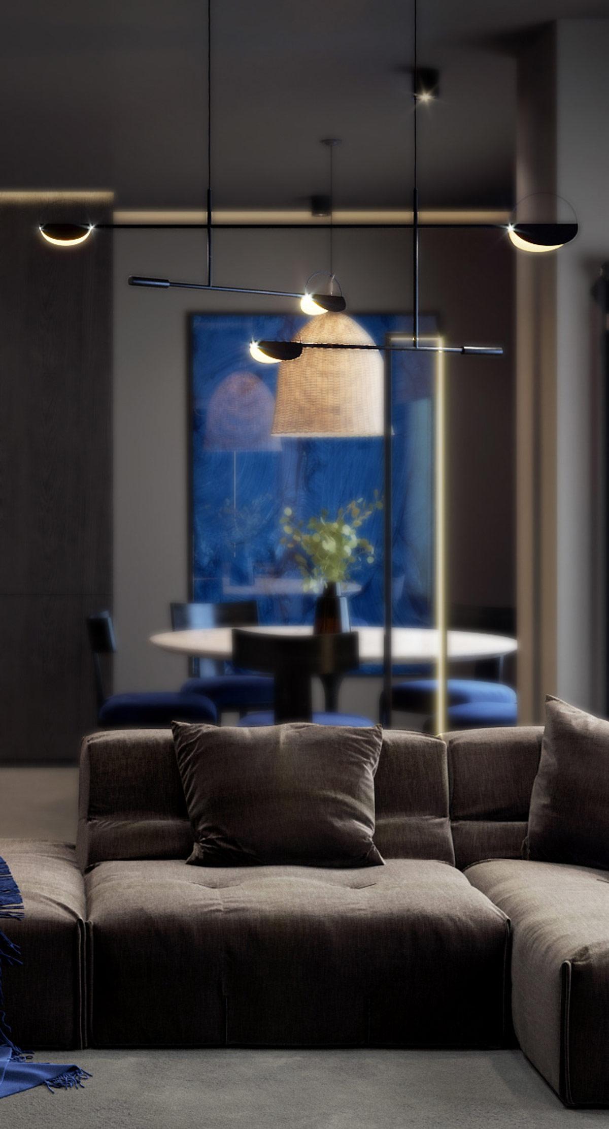 Những chiếc gối ném được phối hợp màu sắc tạo chiều sâu cho sự thoải mái trên ghế sofa hiện đại mà không phá vỡ tính thẩm mỹ kín đáo