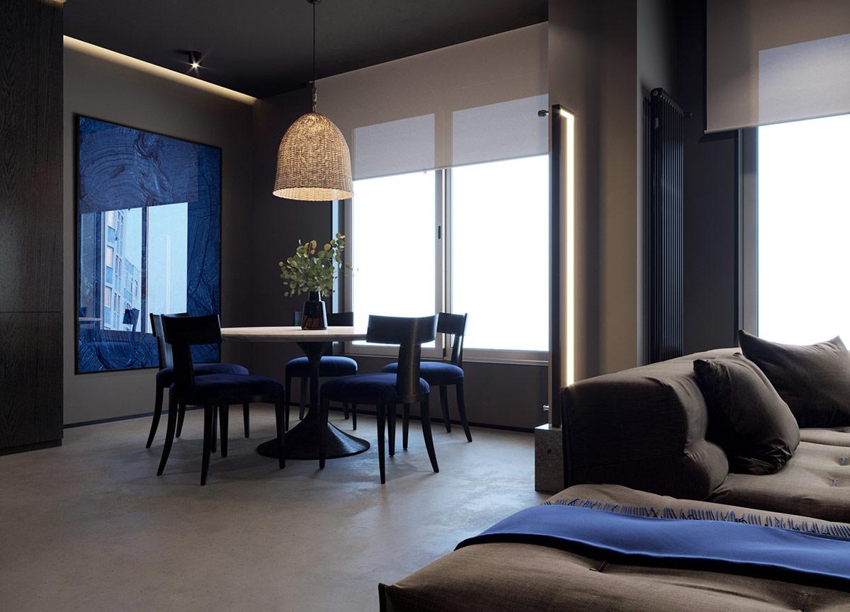 Một chiếc đèn sàn hiện đại làm nổi bật điểm chuyển tiếp của combo phòng khách phòng ăn