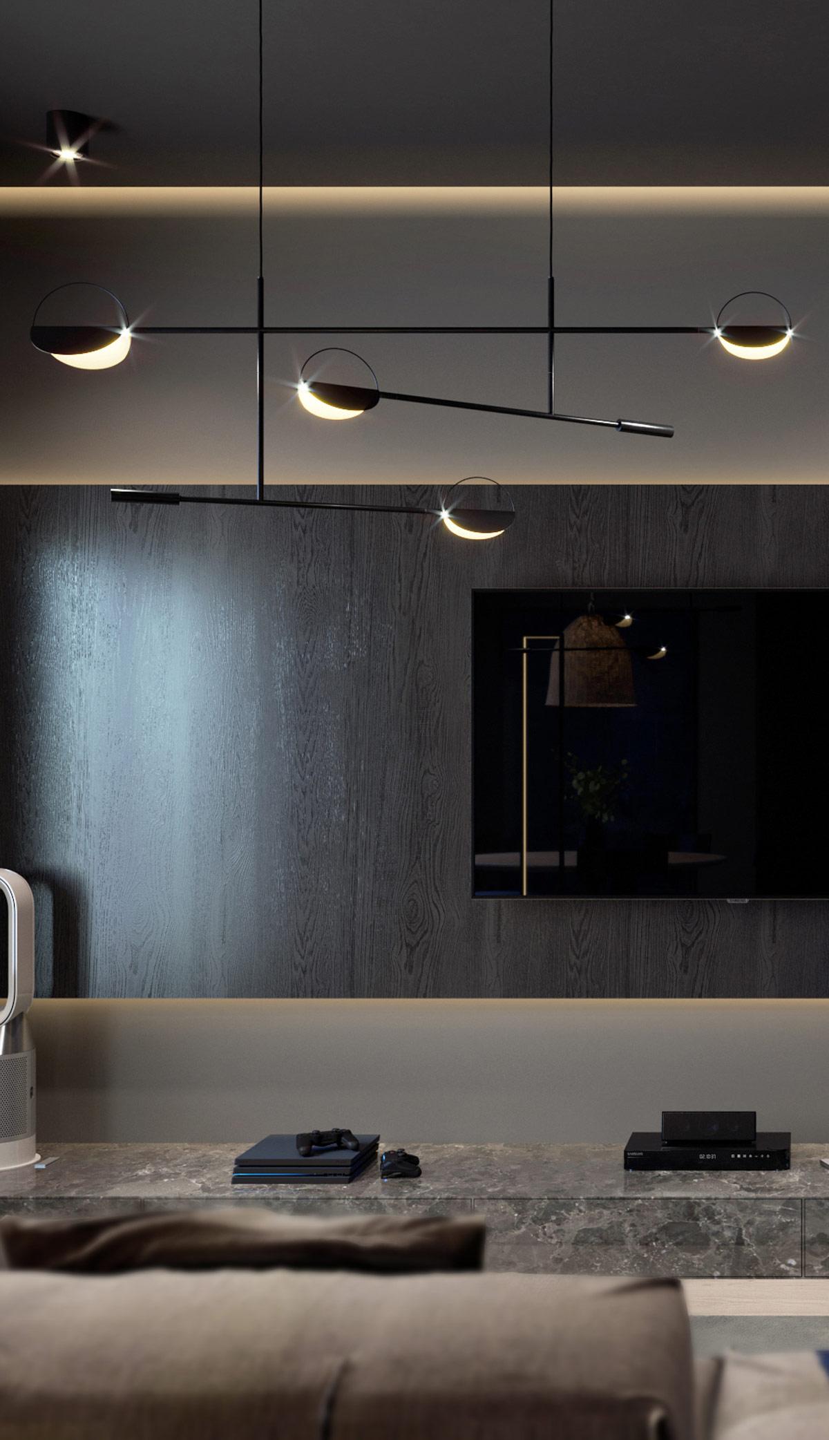 Các dải ruy băng LED bao quanh mép của giá treo TV, tạo ra một bầu không khí ấm áp