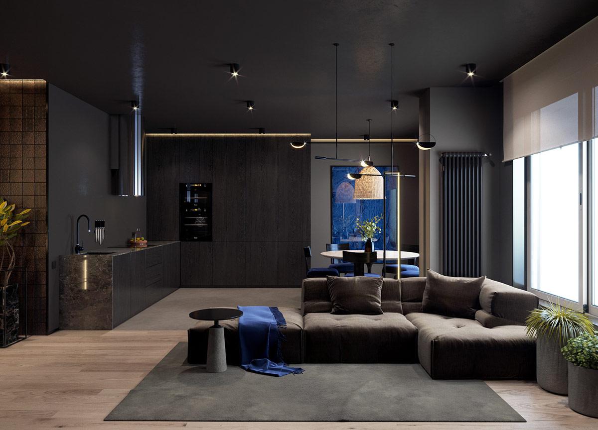 Ngôi nhà trở nên sống động với tia lửa điện màu xanh lam và cây xanh trong nhà. Một chiếc ghế sofa mô-đun cắt ngang qua trung tâm của bố cục không gian mở để xác định sảnh tiếp khách với khu vực bếp và ăn uống.