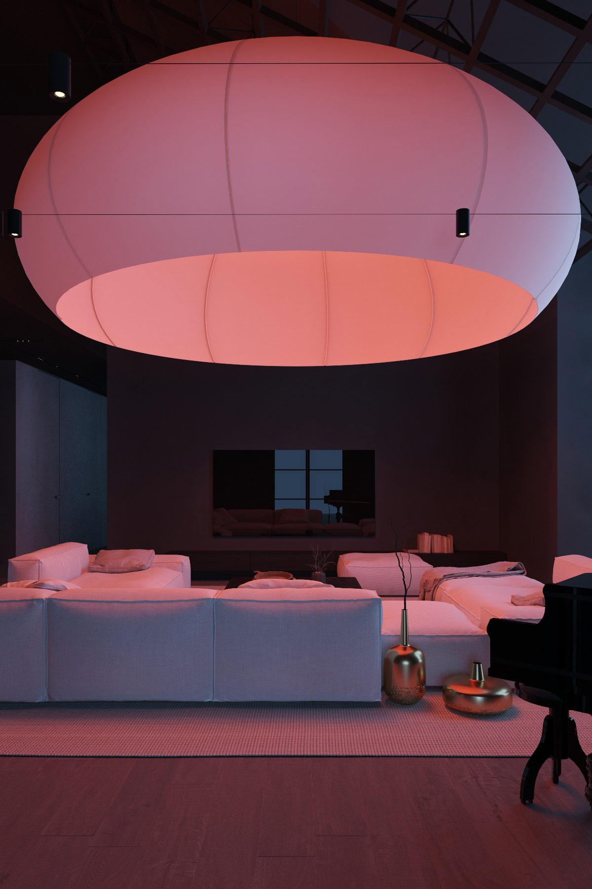 Một chiếc ghế sofa trắng kiểu mô-đun trở thành một tấm bạt để thay đổi màu sắc bên dưới chiếc dù chiếu sáng tuyệt vời