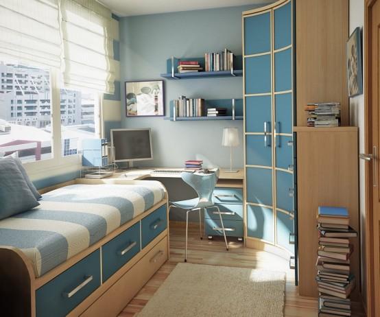 một căn phòng nhỏ đầy phong cách dành cho thanh thiếu niên màu xanh da trời và da rám nắng với giường có ngăn kéo để lưu trữ, bàn ở góc và tủ quần áo cong, kệ nổi và sách xếp chồng lên nhau