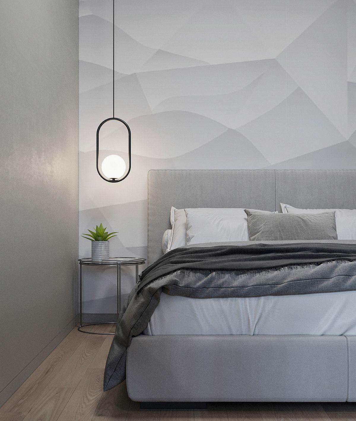Phòng ngủ được đánh bóng với màu xám với phong cách công nghiệp đương đại