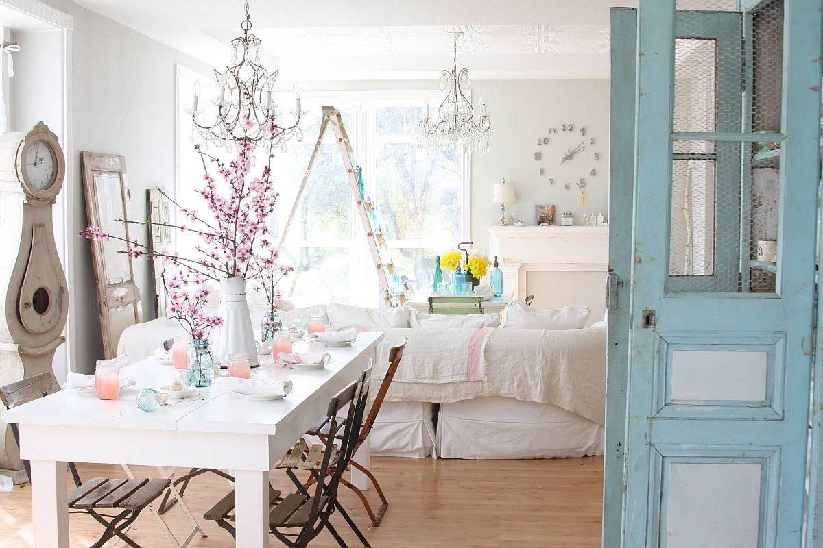 Không gian ăn uống và phòng khách với lối trang trí màu trắng và đồ đạc tự nhiên phong phú